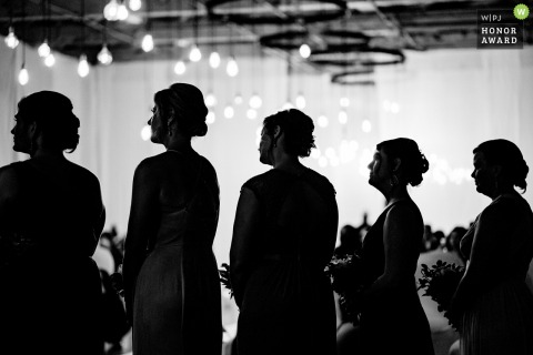 NJ wedding photo in black and white from the art factory, new jersey showing Silhouette of brides maid during ceremony