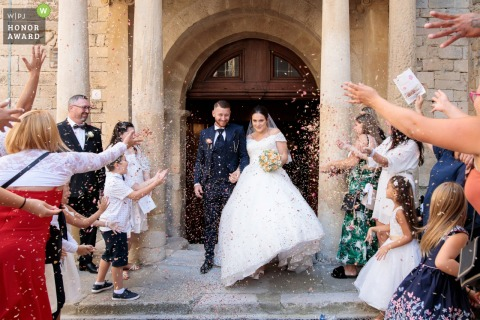 France outdoor wedding photo from the Church of Balaruc le Vieux showing the Exit from the bride and groom church