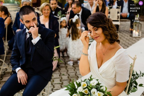 Wedding photography from Borgo San Faustino, Orvieto - the groom is looking at her bride while she cannot hold her tears