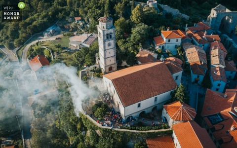 Drone wedding photo from Kvarner, Croatia as the Best men's head football torches to make a spectacular scene, but Instead they almost burn down the whole village