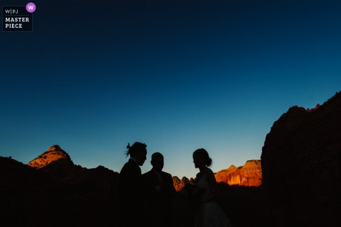 Wedding photography from Zion Canyon showing the dramatic Ceremony during the Sunrise