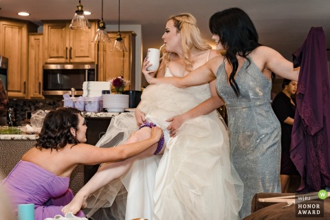 California vacation rental home wedding photography from the Airbnb during Getting Ready showing Teamwork at its best - bridesmaids help the bride get ready in any way possible