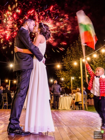 Wedding photography from Mogilovo, Bulgaria. Midalidare Estate showing The newlyweds kiss during the fireworks