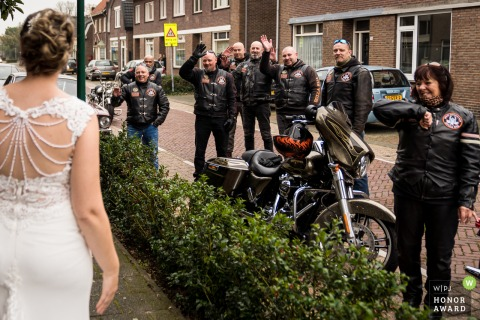 Noord Brabant wedding photography created In front of the home of the bride showing the Biker friends are meeting the wedding couple