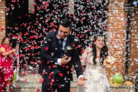 Wedding photography from a church in Novara, Italy - Red and White confetti!