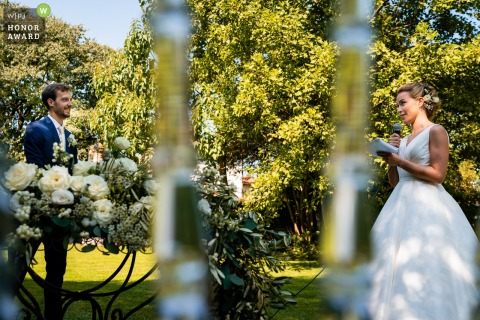 Italy garden wedding photo from an outdoor ceremony at Cervignano, Udine, Italyduring the Bride vows