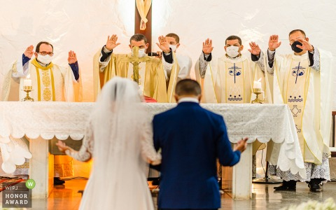 Alagoas church wedding photography from a Maceio ceremony of 4 priests blessing the bride and groom at their wedding