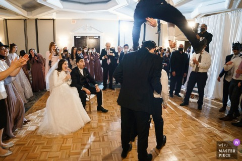 NH wedding photography from the DoubleTree by Hilton Nashua of crazy dance tricks at The reception
