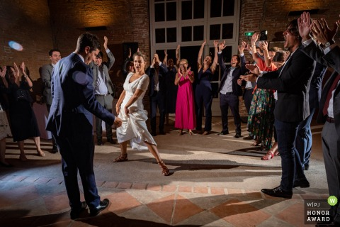 Wedding photo from Toulouse, Domaine de Rochemontes, France as the couple dances with guests around