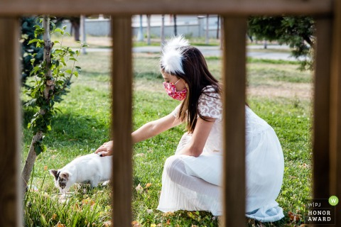 Istanbul outdoor wedding photo from Turkey of the flower girl petting a cat