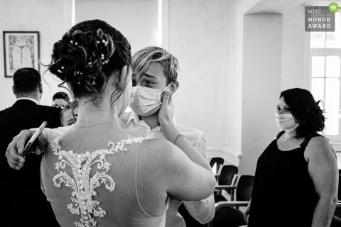 France wedding photography from Auvergne-Rhône-Alpes city hall showing son of the bride who cries when she sees her
