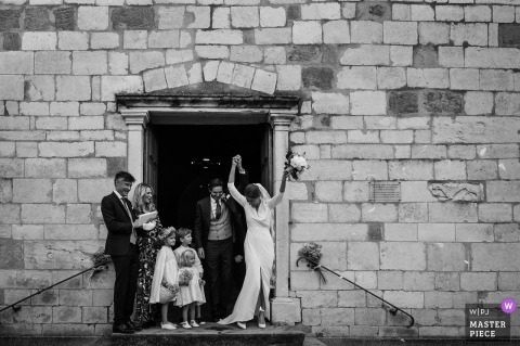 Lyon wedding photo outside a Auvergne-Rhône-AlpesChurch of the Happy couple exiting the building
