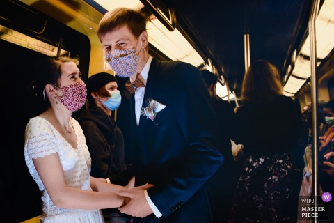 Toulouse Metro wedding photo of the bride and groom smiling under their masks