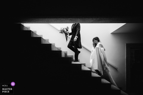 Black and white wedding photo from Peso da Régua, Quinta da Pacheca, Portugal of the bride heading up the stairs