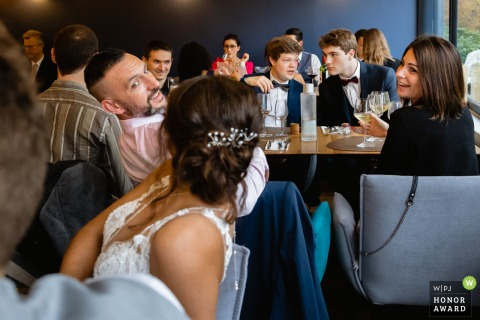 Paris wedding photographers captured this image of the bride talking with her guests keeping distance between tables