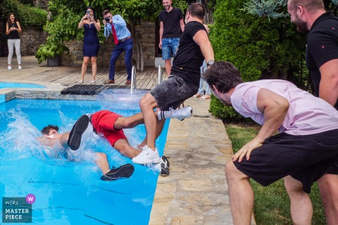 Mogilovo, Bulgaria wedding photography showing The groom's friends throw the best man in the pool before the preparation