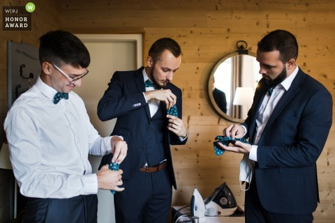 French wedding photography of all the groom witnesses wondering how to fold the pocket square