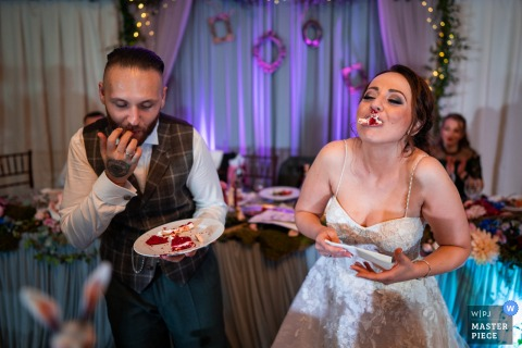 Bulgaria Restaurant wedding photography showing the new couple enjoying their Nice cake