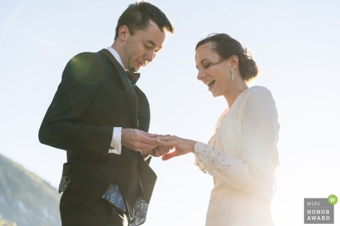 Colorado couple exchanging rings during their outdoor ceremony