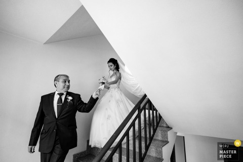 Sofia, Bulgaria wedding photography showing a traditional custom in which the father leads the bride out of her home