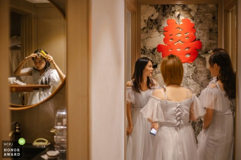 China wedding photo from a Zhejiang Home	showing Wedding documentary in Asia as the bride and bridesmaids prepare