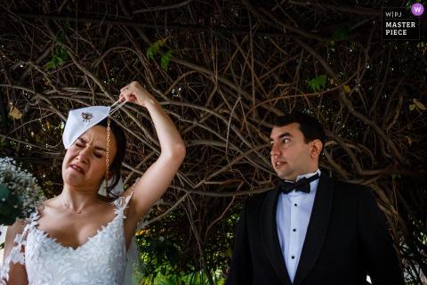 sisli nikah salonu, istanbul, turkey wedding photo of the couple removing the masks after the ceremony