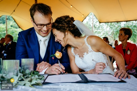 Netherlands Ceremony wedding photography created as the bride is signing the wedding contract