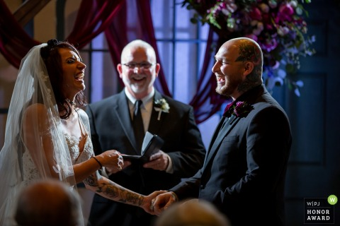 Ohio wedding photography from Columbus showing the couple during a ceremony laugh