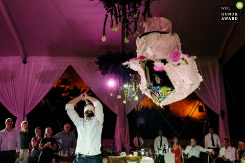 Oaxaca City wedding photographer captured the smashing of a wedding piñata at the Jardin Etnobotanico