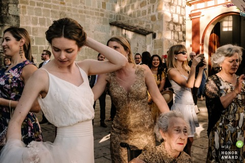 Oaxaca wedding photography from Oaxaca City of wedding guests and bride outdoors