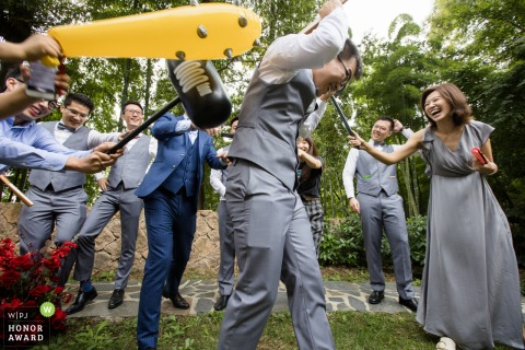 China outdoor pre-wedding photo from Hangzhou showing the grooms men Play the game