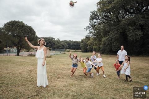 La Fenière, Pavie, France wedding photo of The launch of the bouquet
