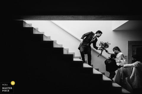 Peso da Régua - Quinta da Pacheca, Portugal wedding photo of the groom helping the bride climb the stairs
