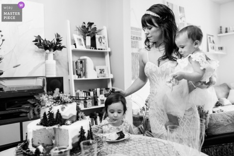 Pennsylvania Home wedding photo showing the Bride taking a moment with her two daughters before they leave the house to head into the mountains for their elopement ceremony