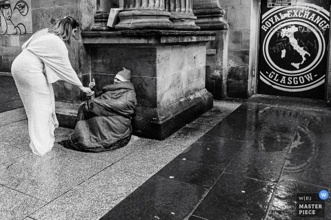 Glasgow City Centre wedding photo showing the bride being kind and giving help