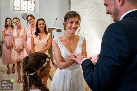 French wedding photography from Rembouillet showing the bride putting the ring on the grooms finger