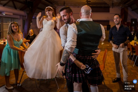Bas-Rhin Reception wedding photography of the kilt game at the party