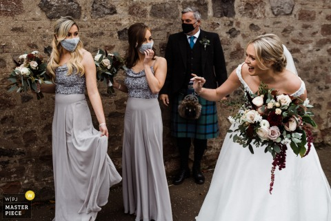 Lindores Abbey Distillery, Newburgh wedding photo showing the Bride before the ceremony with bridesmaids
