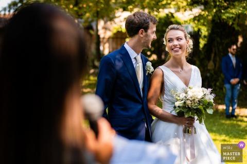 Castello di Strassoldo, Cervignano, Italy wedding photo of Smiles during an outdoor garden ceremony