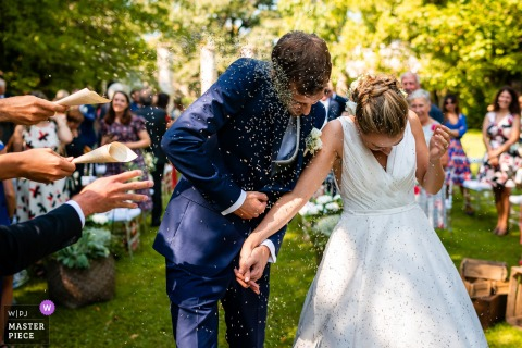 Castello di Strassoldo, Cervignano, Italy wedding photography of an outdoor garden Confetti moment