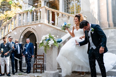 Trieste outdoor wedding photograph from a Italy ceremony showing the Confetti moment