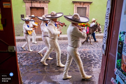 Casa Chorro, San Miguel de Allende, Guanajuato, Mexico wedding photo of the Mariachi band members walking during a wedding parade
