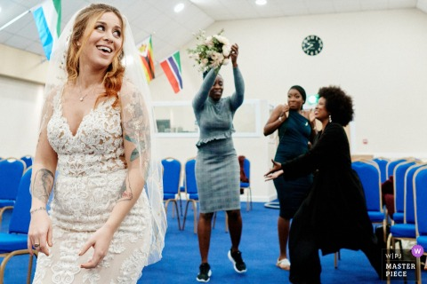 Church in Croydon, UK bouquet toss wedding photo
