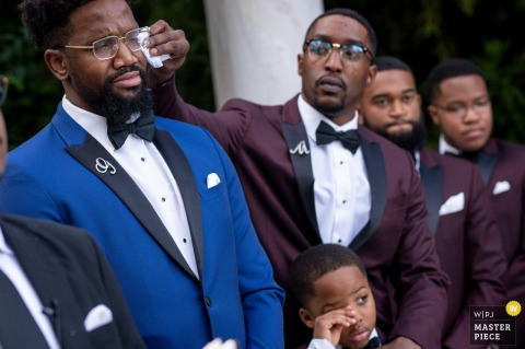 Delaware wedding ceremony image as the best man comforts emotional groom