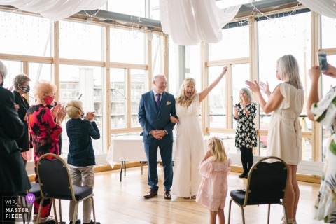 London wedding reportage photo of A couple celebrating getting married at Greenwich Yacht Club