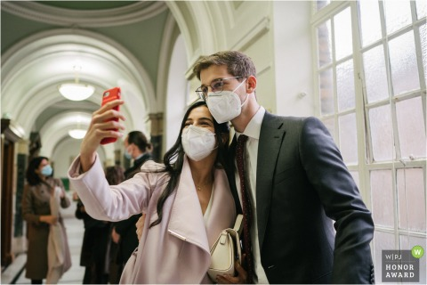 London couple taking a selfie with face masks on at a wedding at the Islington Town Hall