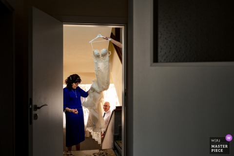 A top wedding photographer in Gotse Delchev, Bulgaria captured this picture showing the bride prepares herself for dressing