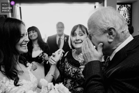 San Antonio best wedding photography from St. George Marolnite Church showing a pic ofthe Texas brides grandfather wipes tears away