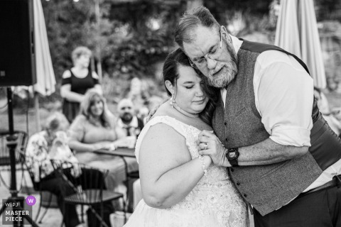 A Nevada wedding photographer in Lavender Ridge created this image ofa Very emotional moment during the father and daughter dance