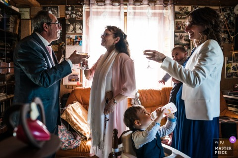 Best wedding photography from Orleans showing a pic from a home wedding showing a child, Wanna do like you